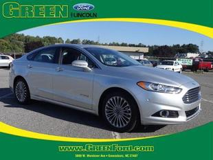 2014 Ford Fusion Hybrid Titanium Sedan for sale in Greensboro for $25,000 with 30,523 miles.