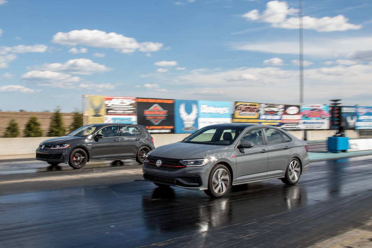 02-volkswagen-jetta-gli-and-golf-gti-2019-angle--drag-strip--dynamic--exterior--front--grey--head-to-head.jpg