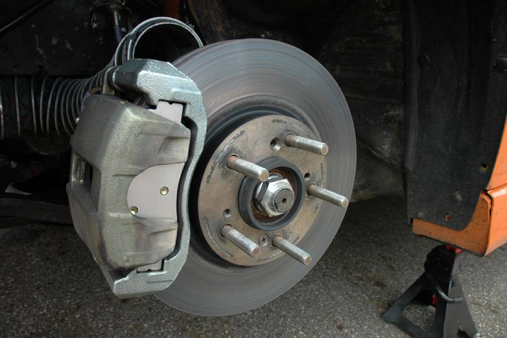 Brake being replaced on a jacked-up car