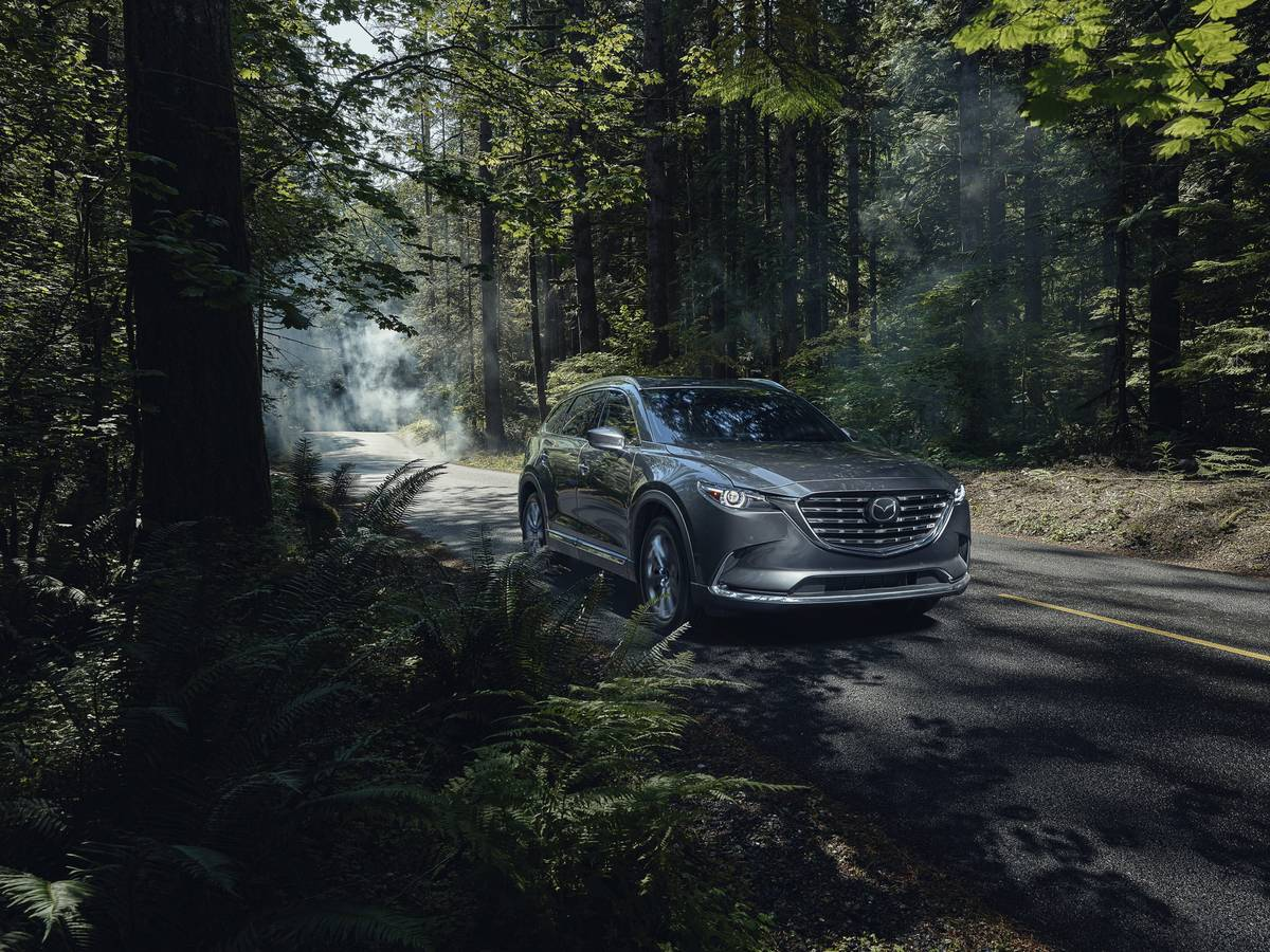 a 2021 Mazda CX-9 driving through a forest