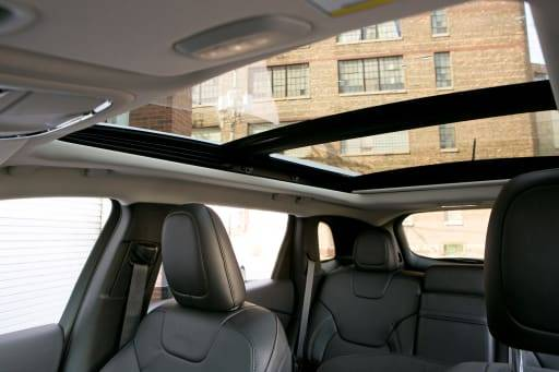 Panoramic moonroof view from the inside of an SUV