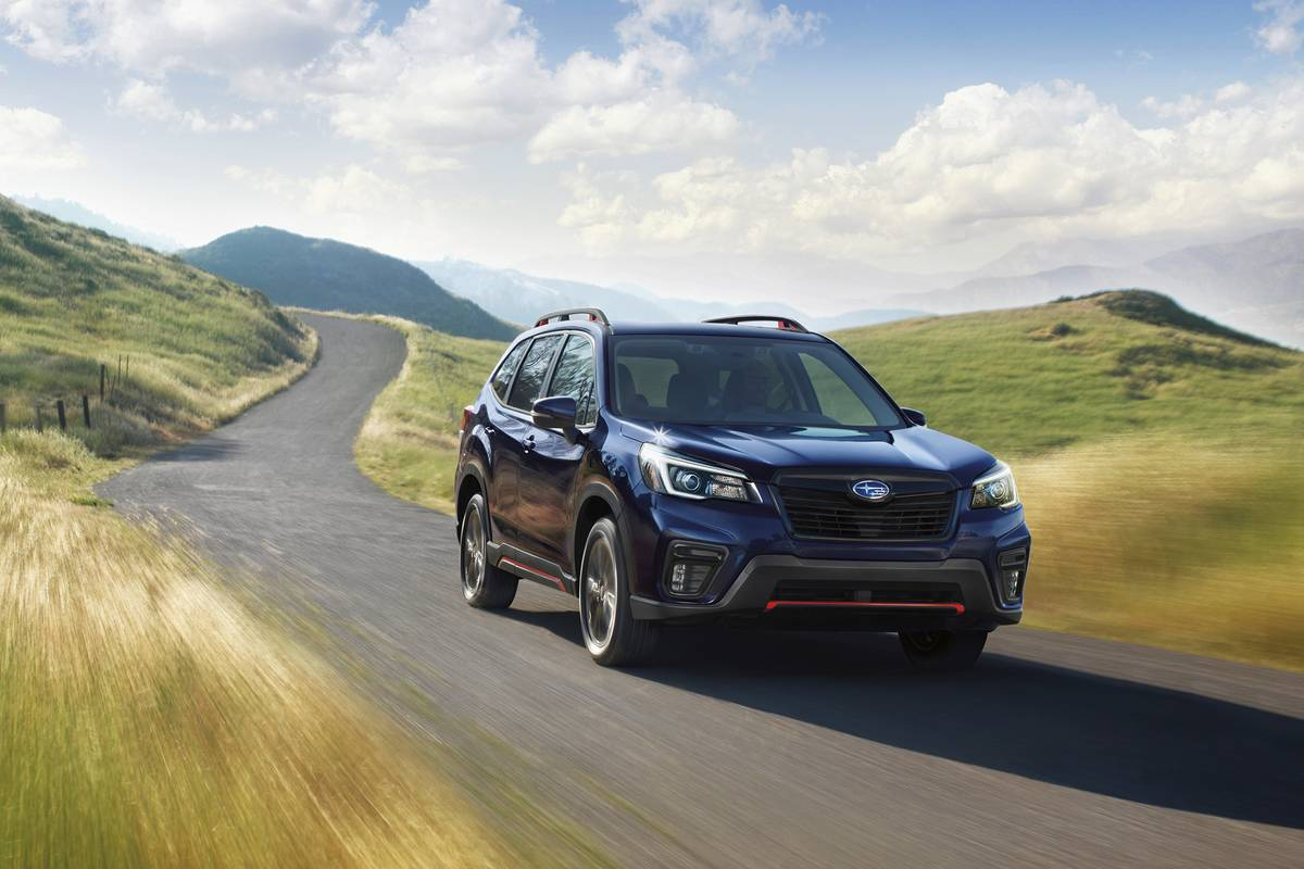 A 2021 Subaru Forester driving on a road