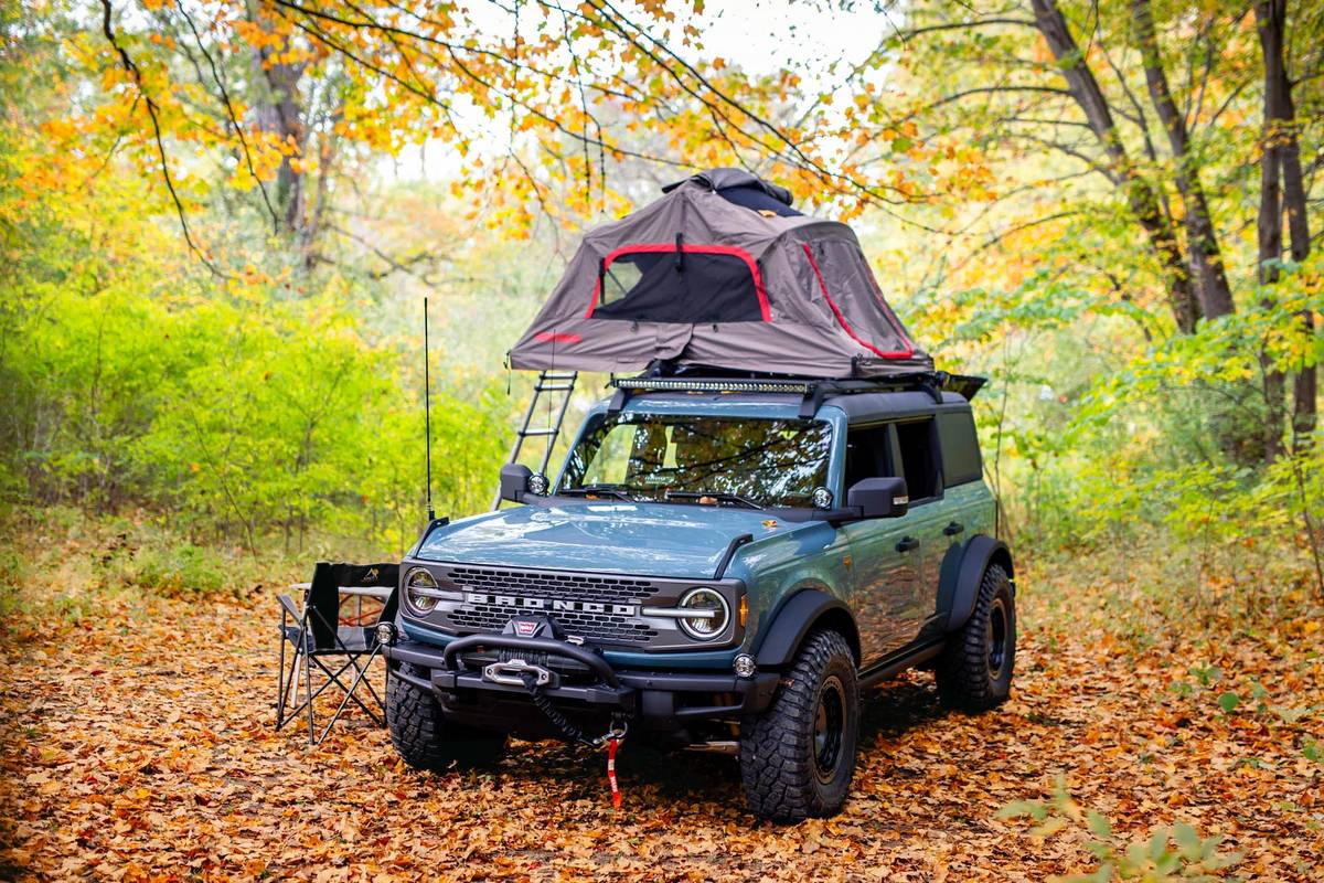 Blue Ford Bronco Overland Concept with a tent on its roof