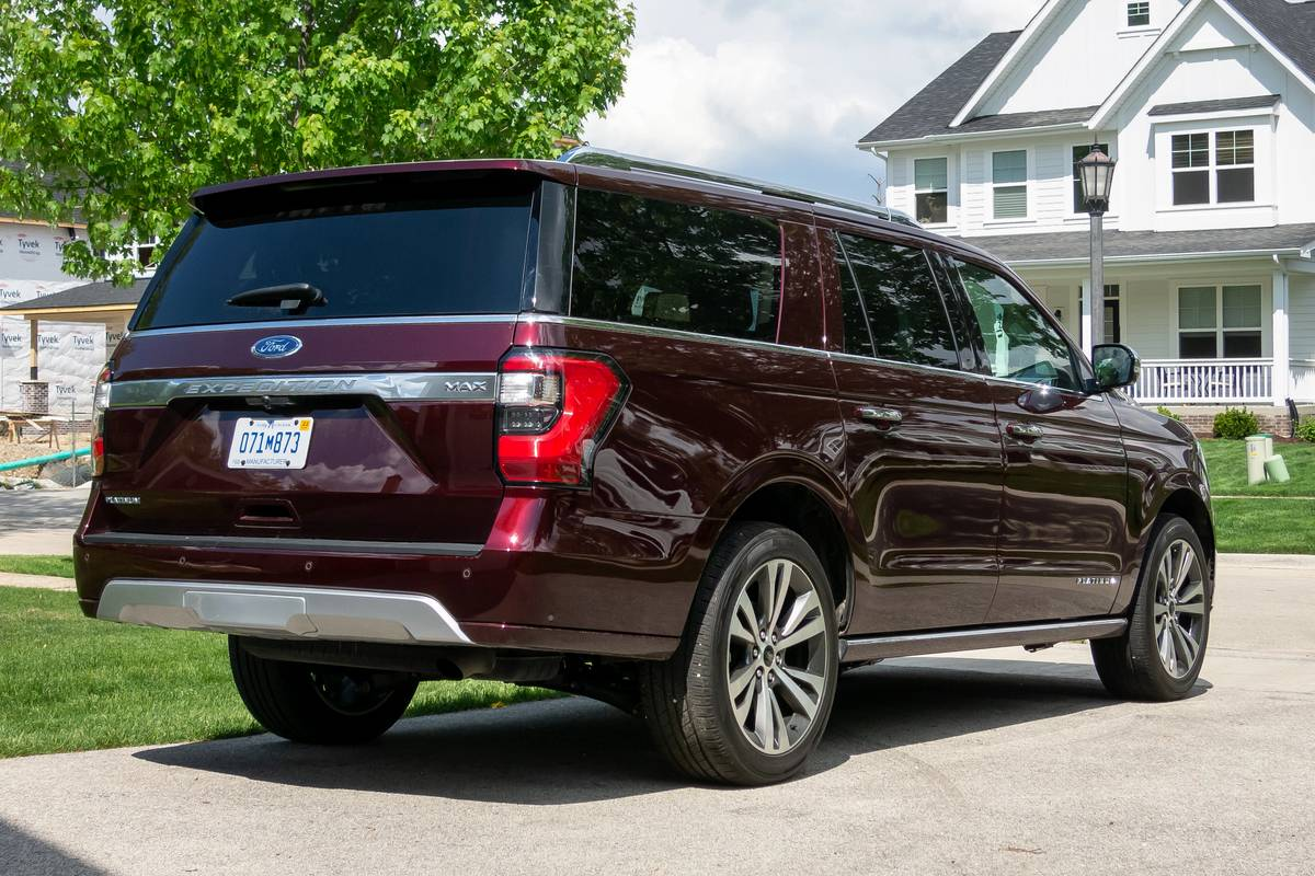 Rear angle view of a maroon 2020 Ford Expedition Platinum Max
