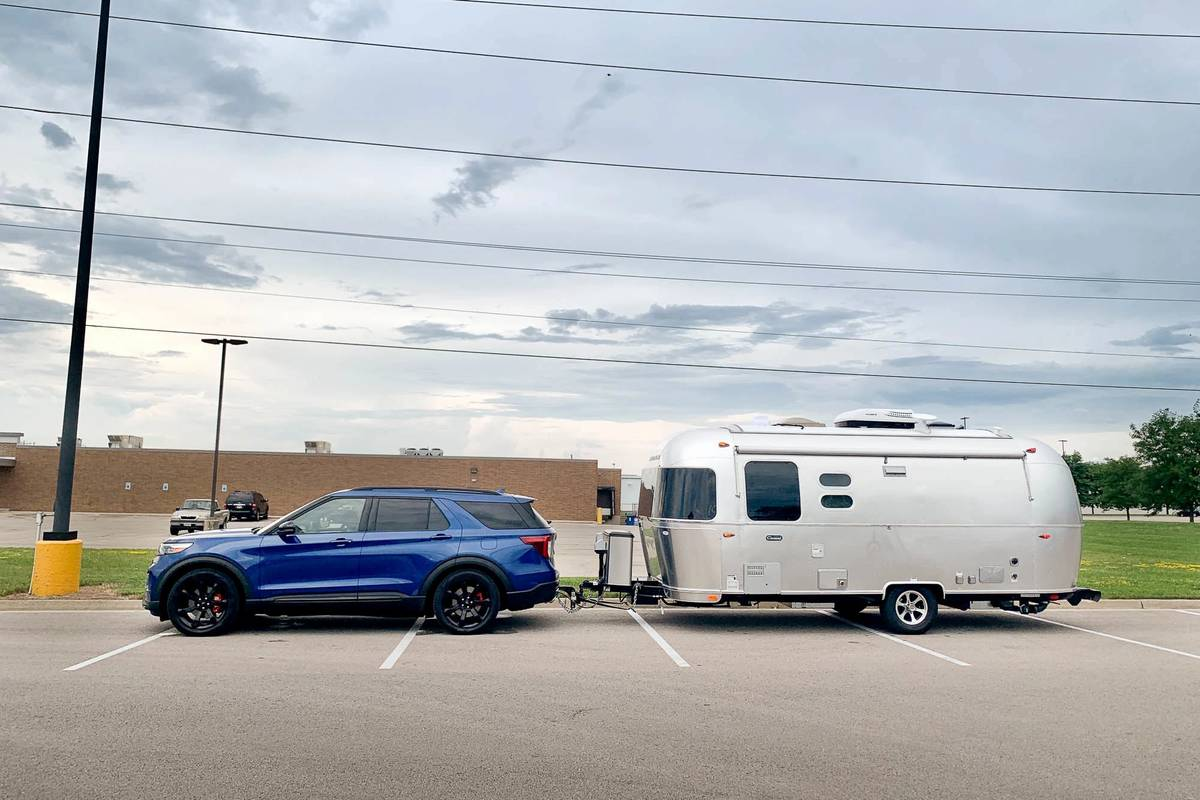 A blue 2020 Ford Explorer towing a trailer