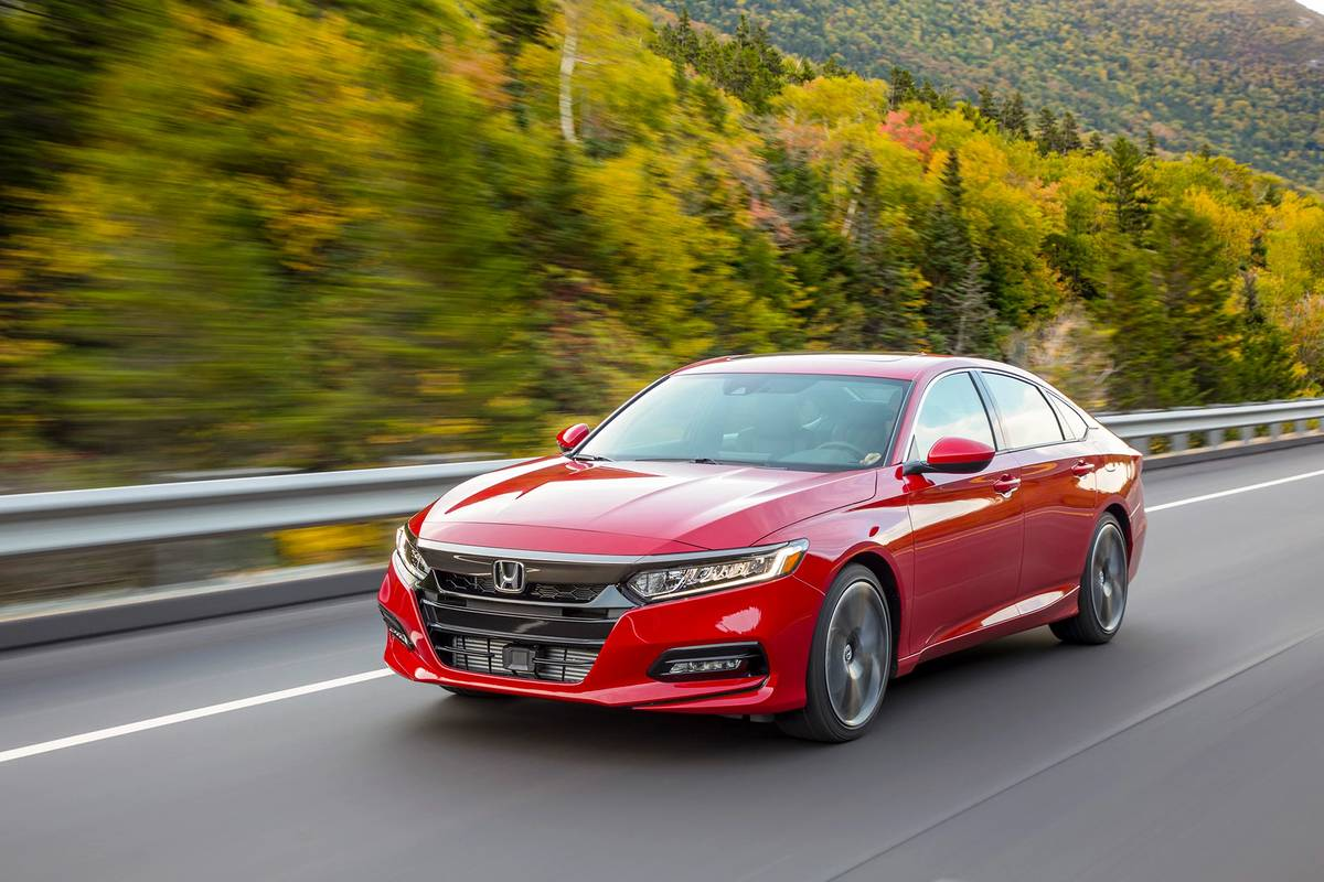 Red 2020 Honda Accord driving on a road