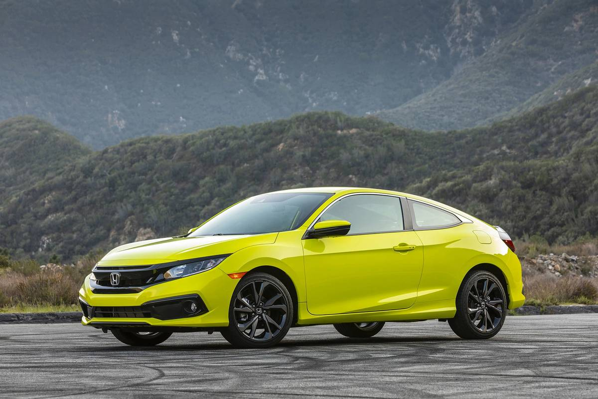 Neon 2020 Honda Civic Coupe parked in front of mountains