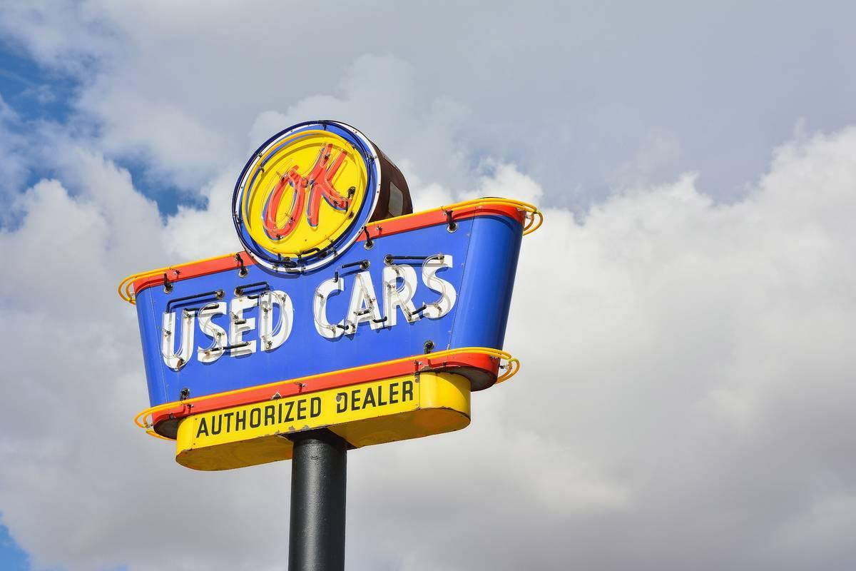 Used car dealership sign