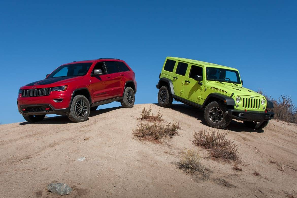 Ultimate Jeep Head To Head Wrangler Rubicon Versus Grand Cherokee Trailhawk News Cars Com