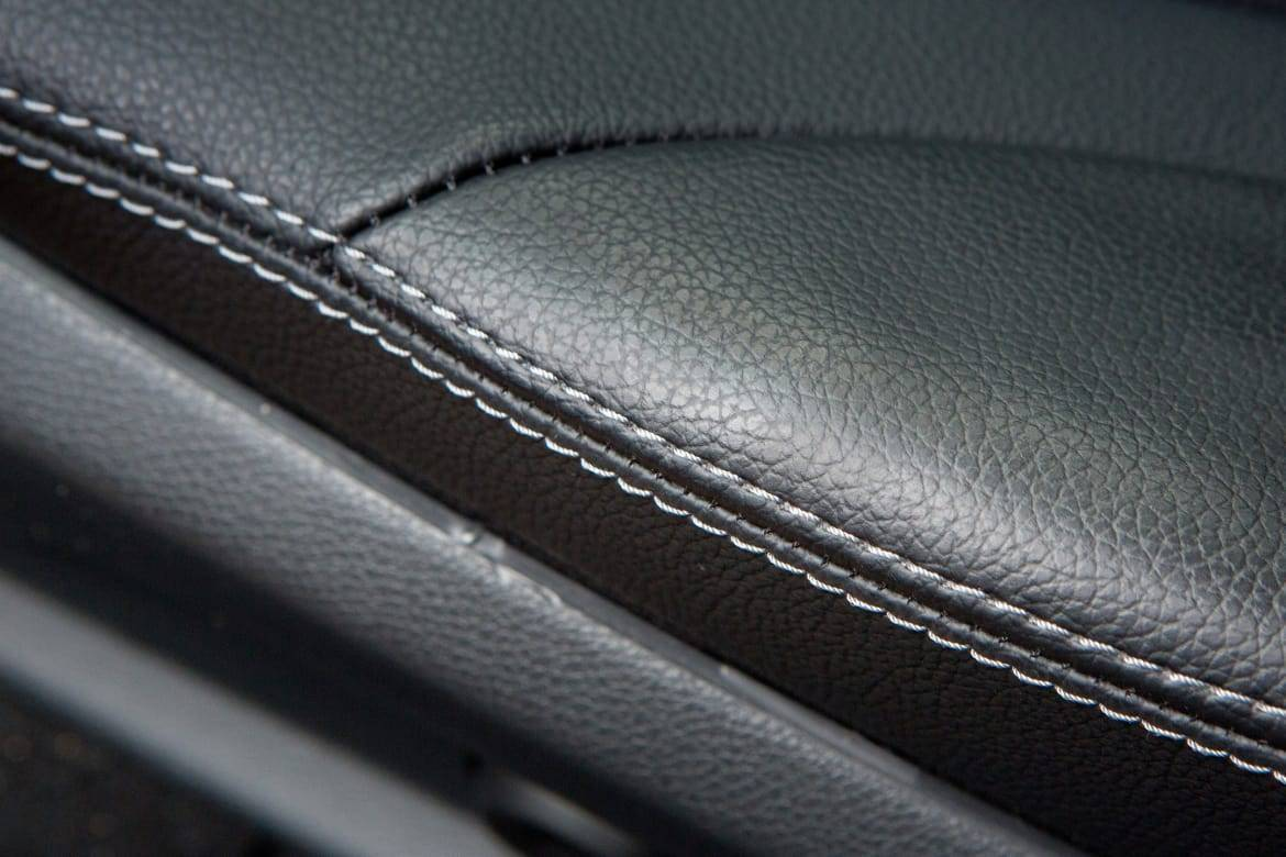 Up-close view of leather upholstery on a car seat