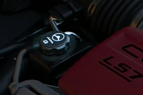 A power steering fluid reservoir cap up-close