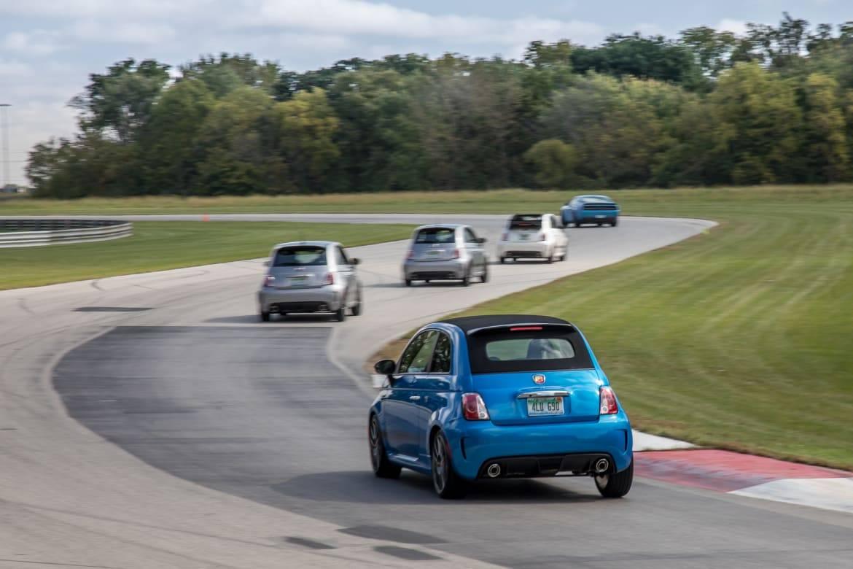 07-fiat-500-abarth-2018-blue--dynamic--exterior--rear--track.jpg