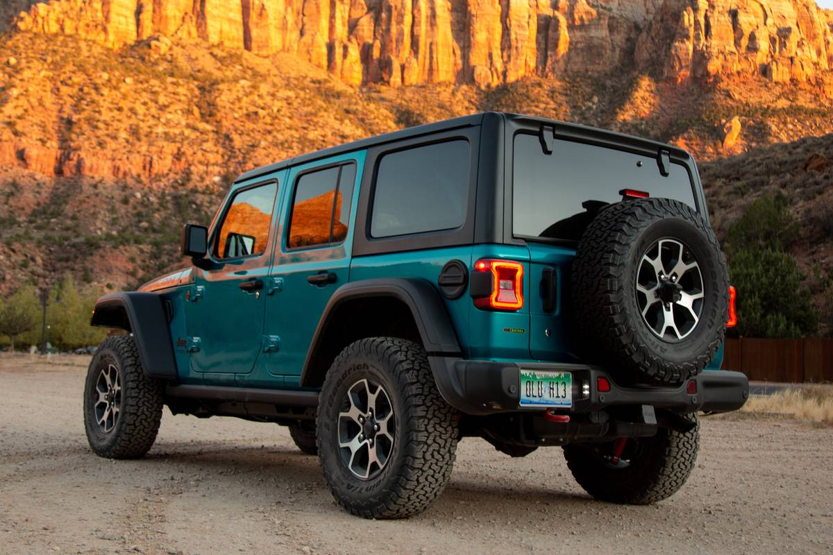 jeep-wrangler-unlimited-eco-diesel-2020-28-angle--blue--exterior--mountains--rear.jpg