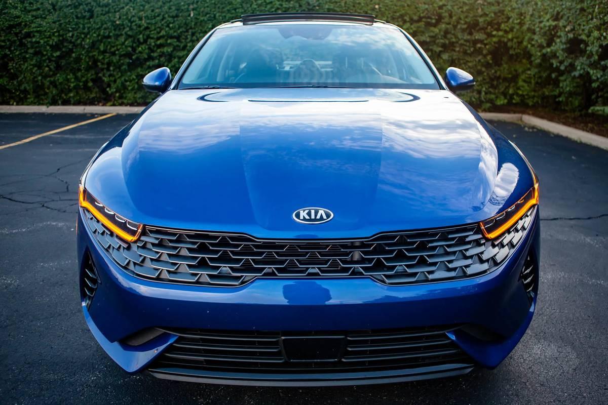 Blue 2021 Kia K5 EX hood, grille and headlights