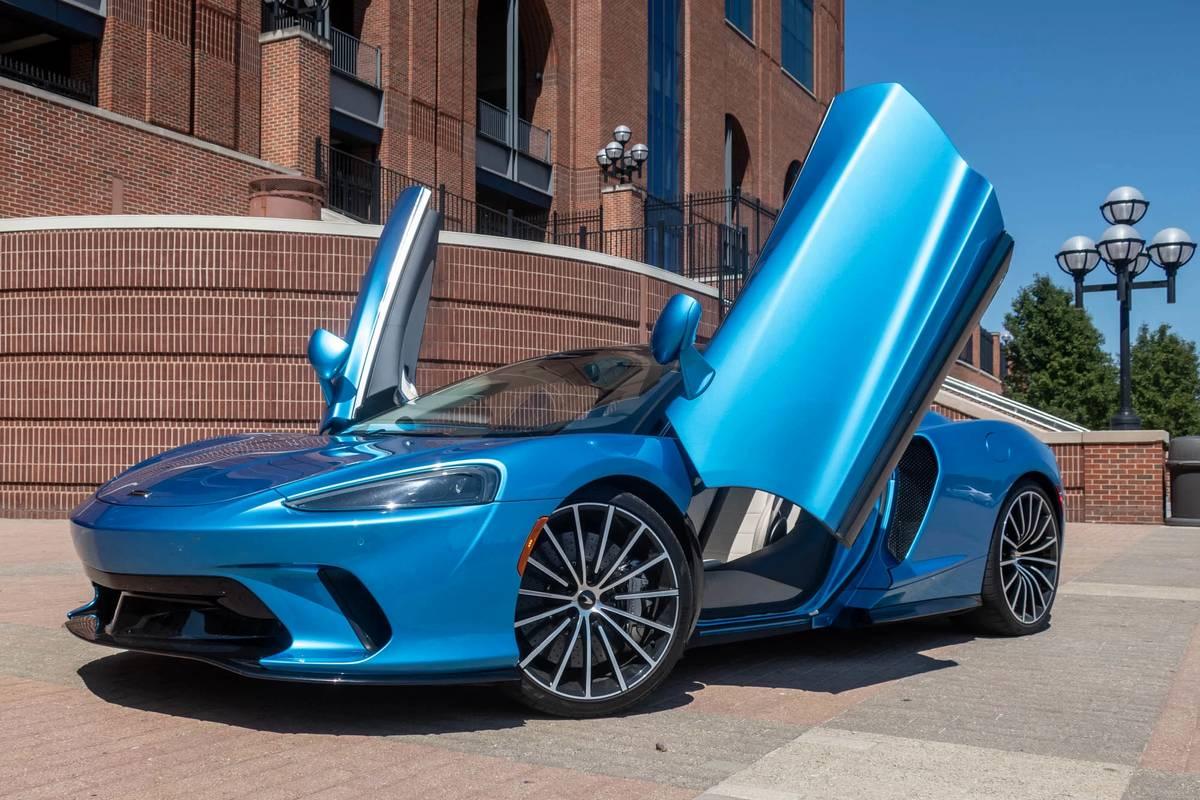 Blue 2020 McLaren GT with suicide doors open
