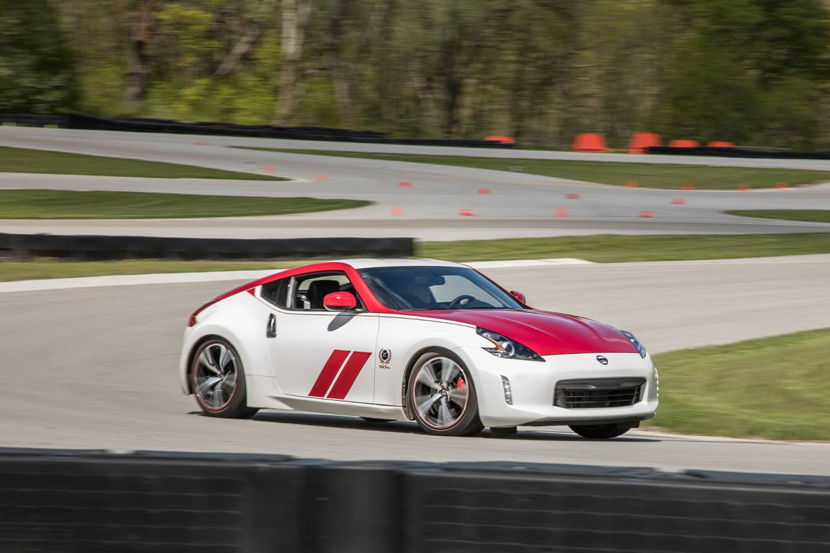 nissan-370z-50th-edition-2019-01-angle--dynamic--exterior--front--red--track--white.jpg
