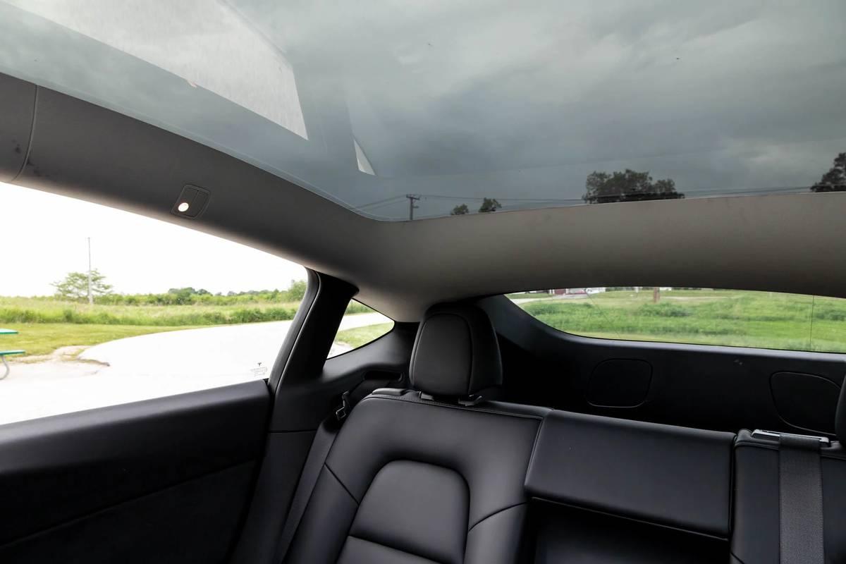 tesla-model-y-2021-39-interior--rear-visibility--sunroof.jpg
