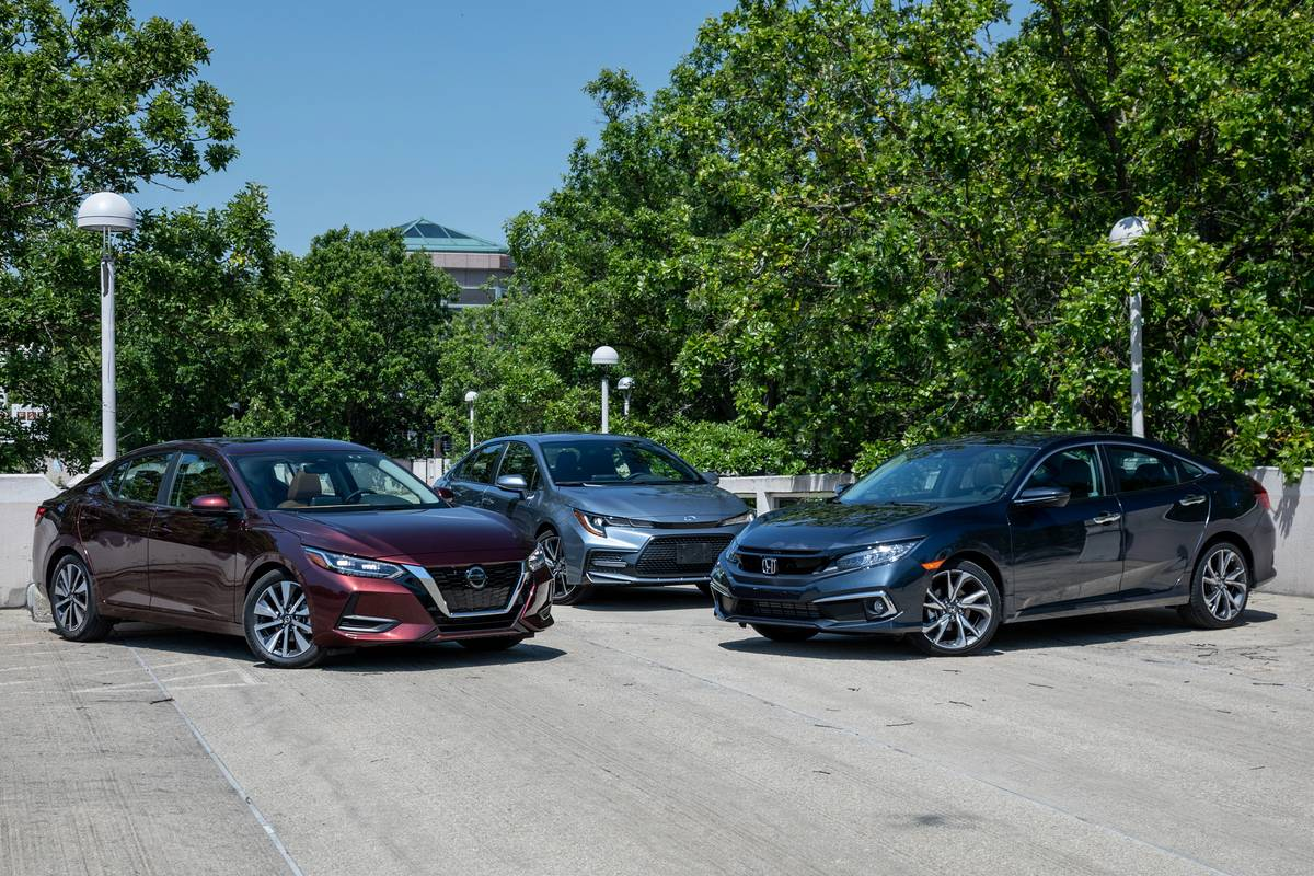 A 2020 Toyota Corolla, 2020 Nissan Sentra and 2020 Honda Civic parked in a row