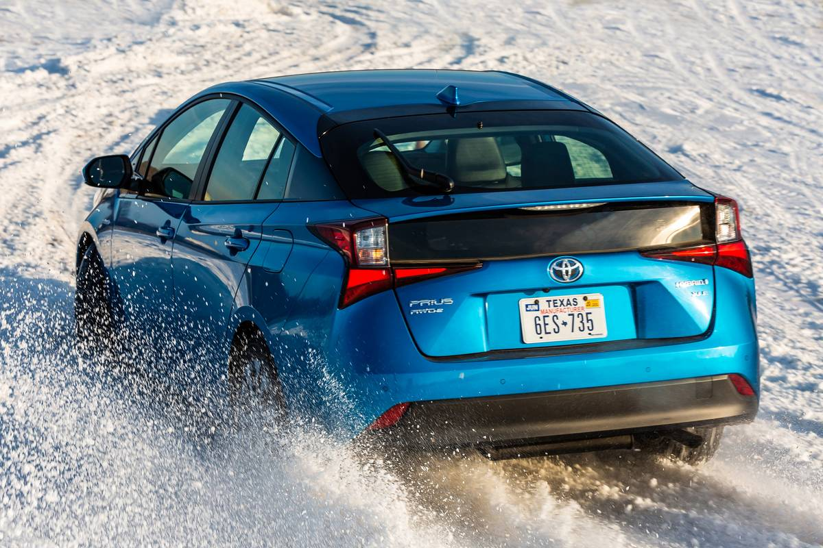 Blue 2020 Toyota Prius XLE AWD driving in snow