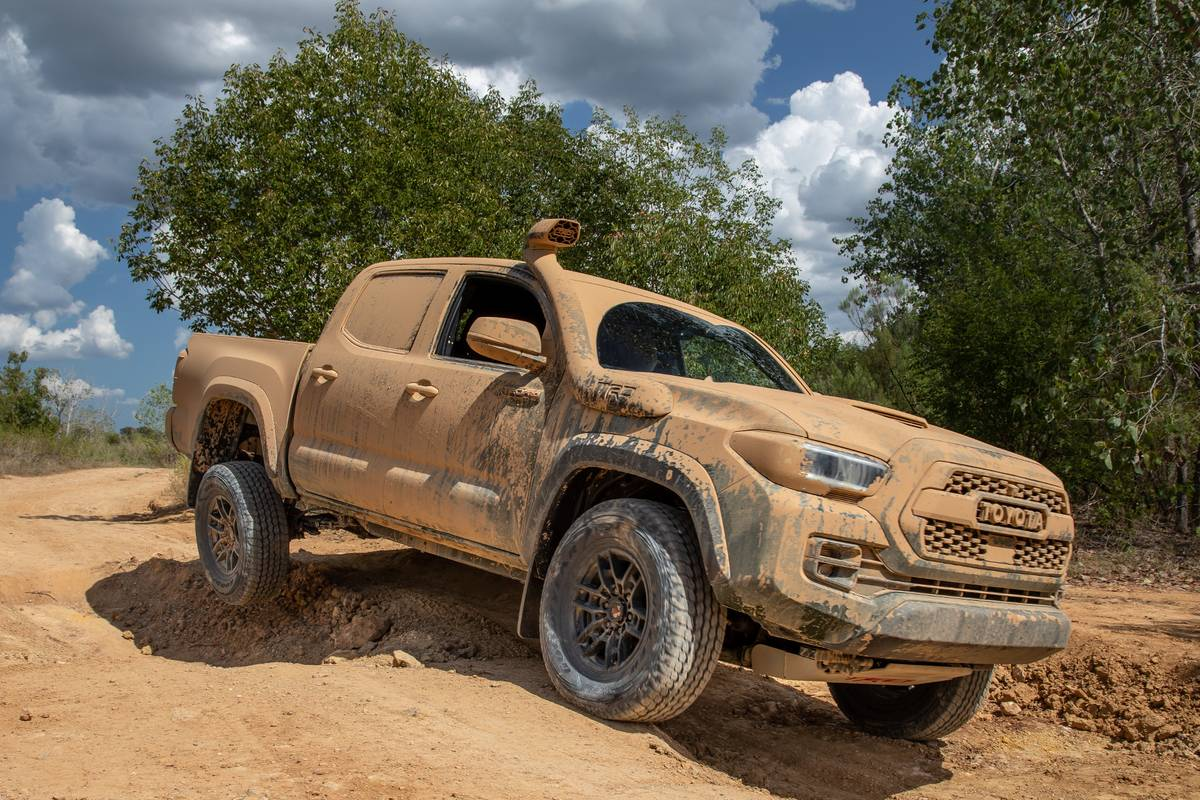 toyota-tacoma-trd-pro-2020-16-angle--dynamic--exterior--front--green--off-road.jpg