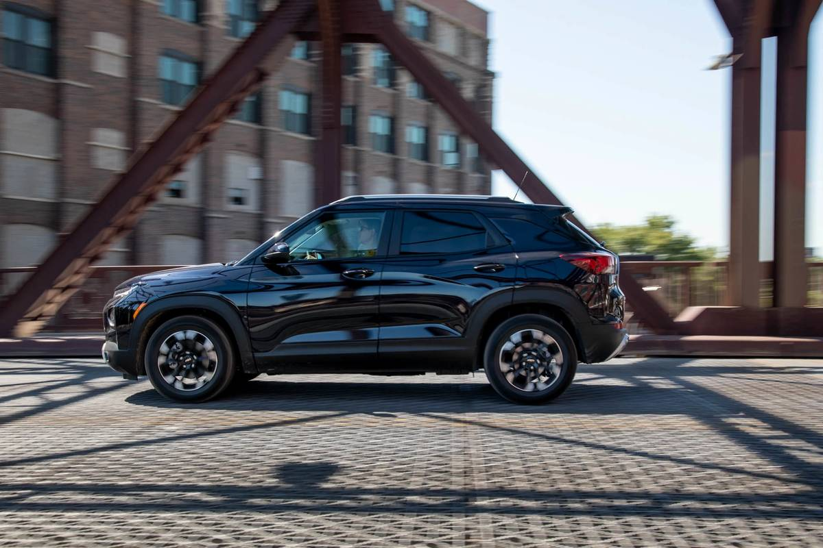 Black 2021 Chevrolet Trailblazer driving on a bridge