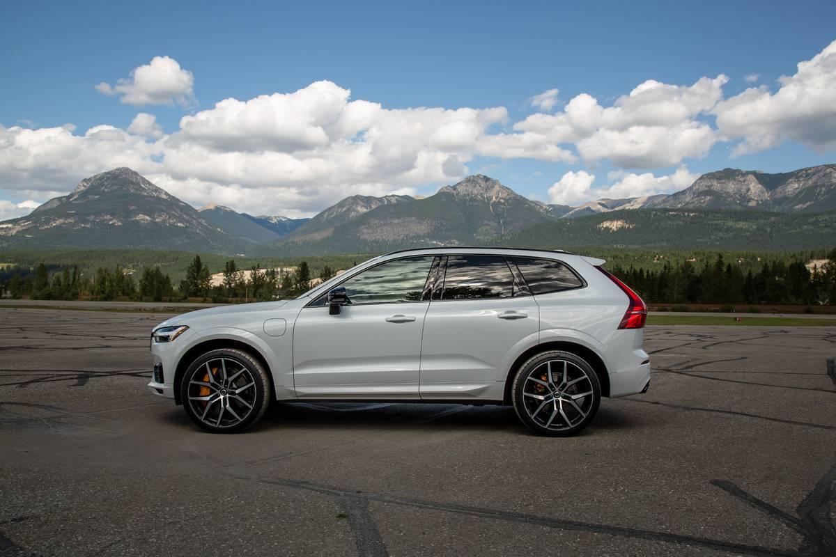 2020 Volvo XC60 T8 Polestar side view parked in front of mountains