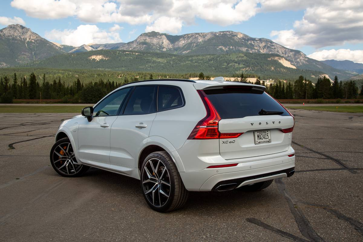 Rear angle view of a white Volvo XC60 T8 Polestar in front of mountains