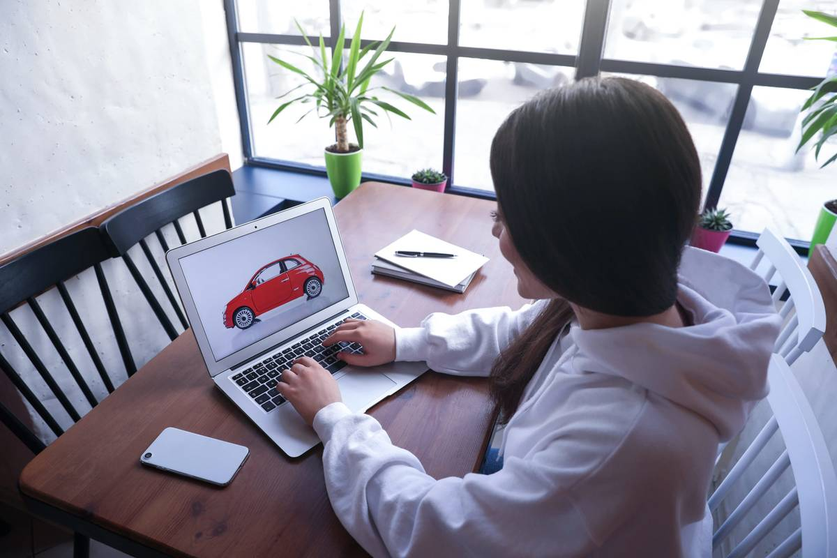 A woman car shopping online