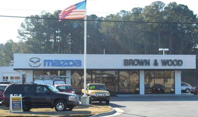 Brown and Wood Buick Cadillac GMC Mazda Image 2