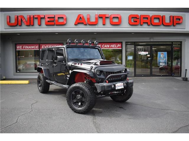used 2013 Jeep Wrangler Unlimited car, priced at $25,995