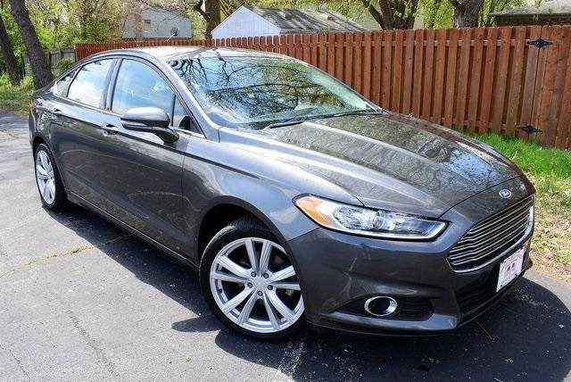 used 2016 Ford Fusion car, priced at $15,375